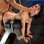 Horny and very naked blonde virgin shows vexation with being bound on her wrists and ankles on lattice bars